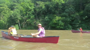 Melinda Meyer and Ben Rorem share a canoe.
